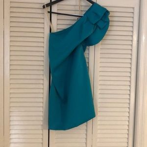 Turquoise one shoulder dress.